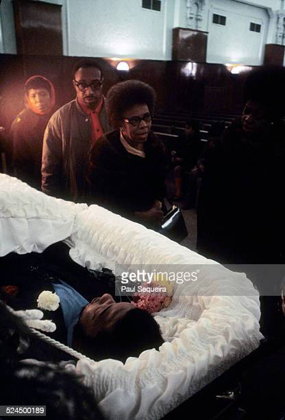 Inside the Rayner Funeral Home members of the community file past the open casket of Fred Hampton the slain Black Panther Party leader to pay last...