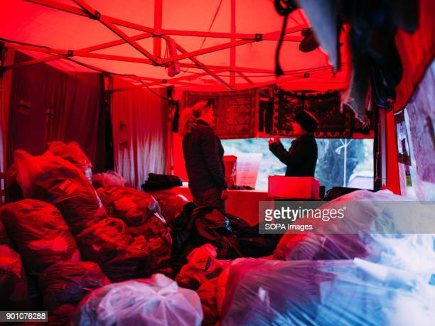 Inside the red tent clothes are piled and ready to be used in case of necessity Dirty Girls of Lesbos is a volunteer group born in September 2015 by...