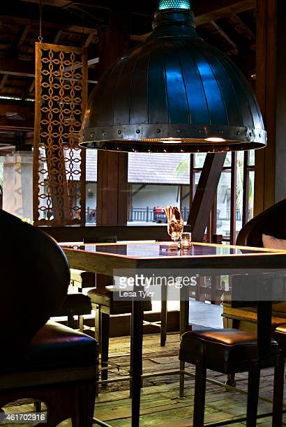 Inside the Rivet Grill restaurant at the Indigo Pearl a 277room property designed by Bangkokbased architect Bill Bensley that reminisces on Phuket's...