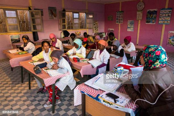 Inside the school with pupils and teacher in Merzouga