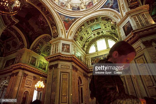 Inside the St Isaac cathedral the city's most opulent with its white marble lapislazuli and malachite interior