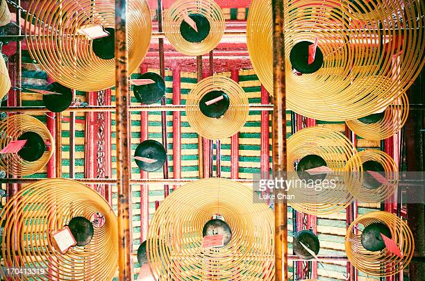 inside the temple - incense coils stock pictures, royalty-free photos & images