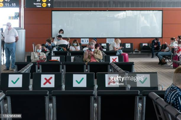 Inside the terminal of Larnaca International Airport Glafcos Clerides LCA during the Covid-19 pandemic. Reduced passenger numbers and flight crew are...