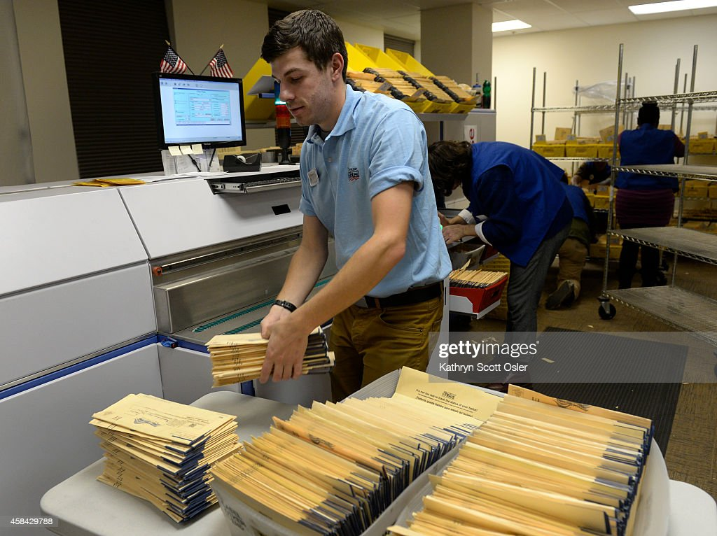 Workers continue processing and counting ballots passed midnight on election night at the Denver Election Division at 200 W. 14th Ave. in downtown Denver. : News Photo