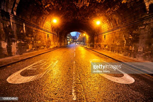 inside tunnel, bridge on king's stable road and castle terrace at night with two bright orange lights reflecting off the wet road, edinburgh - crime and murder stock pictures, royalty-free photos & images