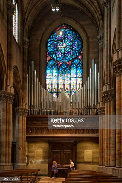 inside view of a church with painted glass and org in rome. - emreturanphoto stock pictures, royalty-free photos & images