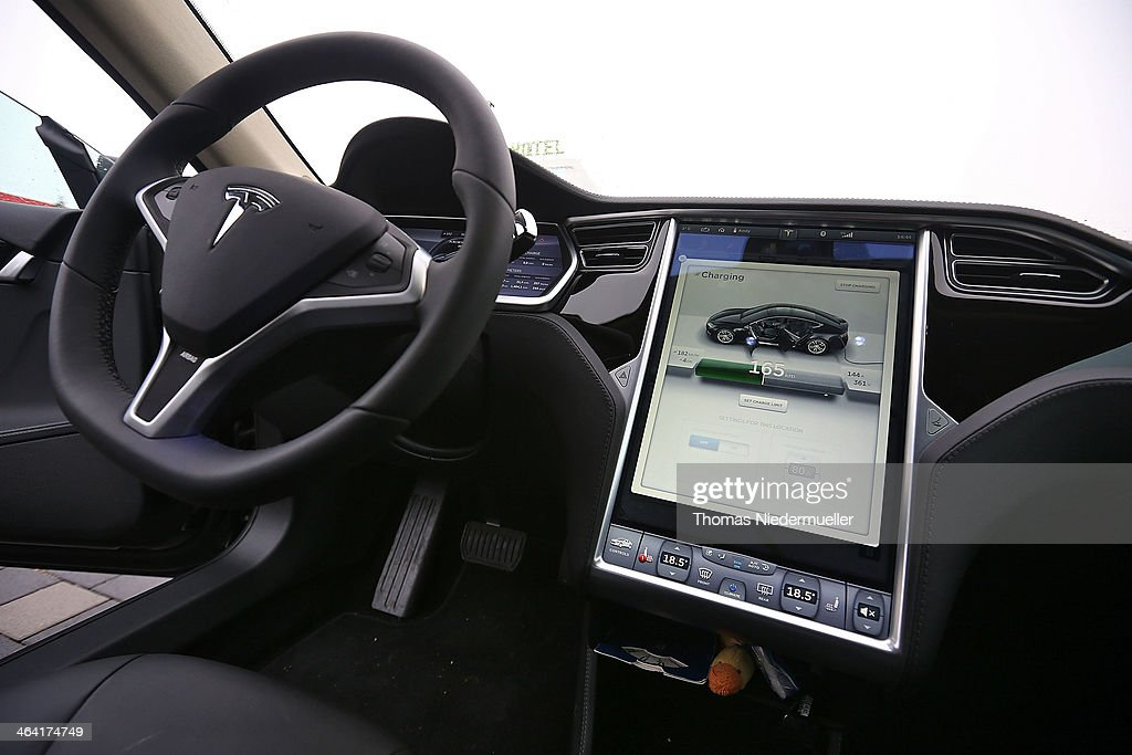 Inside view of a Tesla S 85 electric car while charging at a