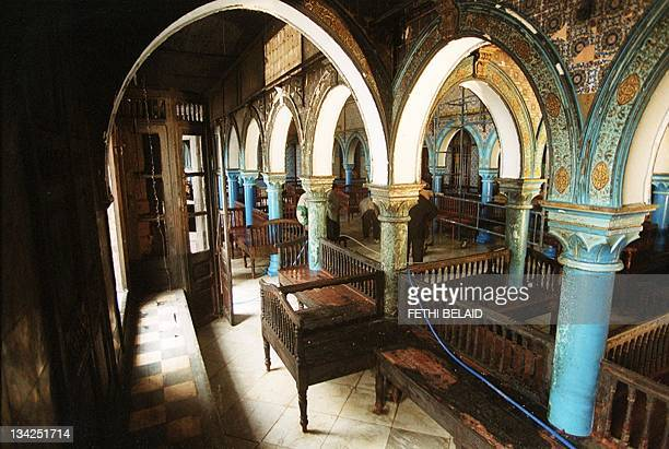 Inside view of the Djerba synagogue South Western Tunisiataken 12 April 2002 after a fuel tanker crashed outside the building 11 April killing seven...