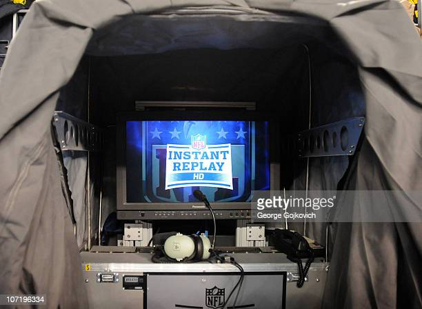 Inside view of the instant replay booth used by game officials to review a challenged play at a game between the New England Patriots and Pittsburgh...