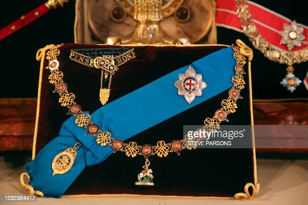 Insignia belonging to Britain's Prince Philip, Duke of Edinburgh, the Garter Collar and Greater George, and the Garter Breast Star and Lesser George,...