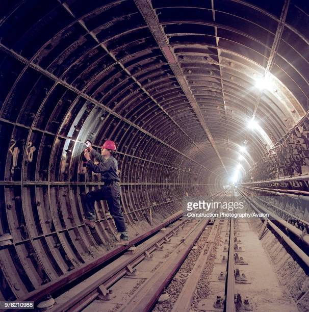 Inspecting segmental tunnel lining during refurbishment of Angel Underground station London United Kingdom