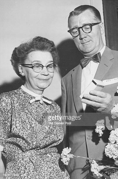 1956 JUL 1 1956 Inspecting the 25year service pin she earned collect¡ing fines on traffic tickets issued to Denver drivers are Mrs Mabel Rieth and...