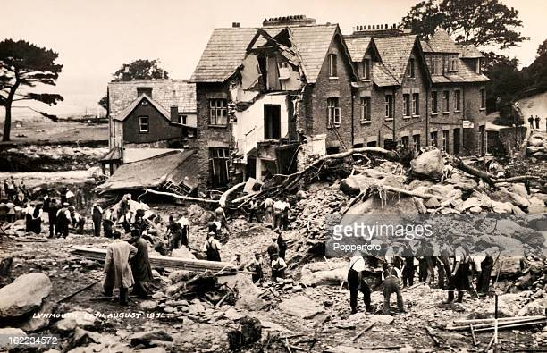 Inspecting the damage to Lynmouth in North Devon following the disastrous flood in which 34 people died and over 100 homes were destroyed or...