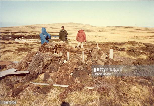 Inspecting the remains of a defensive position in the hills outside of Stanley.