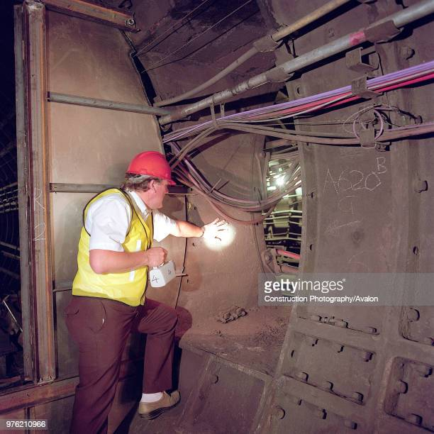 Inspecting tunnel during refurbishment of Angel Underground station London United Kingdom