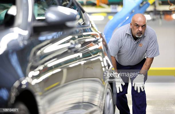 Inspection engineer Jeff Ali checks an MG Motor MG6 saloon automobile at the SAIC Motor Corp's production plant in Birmingham UK on Tuesday Feb 15...