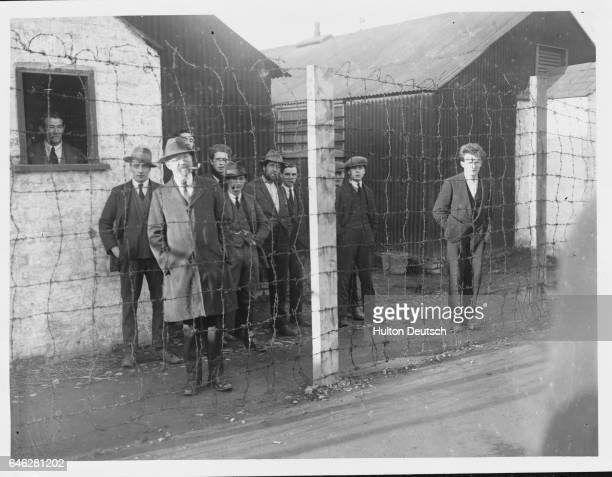 Inspection of Royal Irish Constabulary by Sir Hamar Greenwood Sinn Feiners behind wires