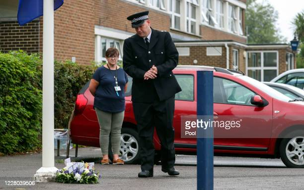 Inspector Al Hawkett lays a floral tribute at the end of a memorial service for Pc Andrew Harper at Newbury Police Station to mark the first...