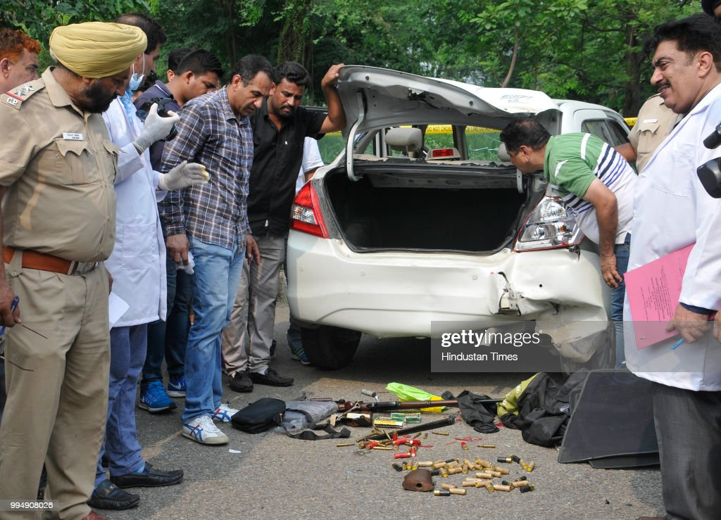 Inspector Amanjot along with others inspect the things recovered from gangster Dilpreet Singhs car while investigating at sector 43 on July 9 2018 in.