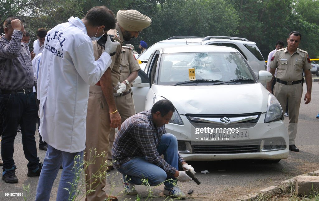 Inspector Amanjot checks gun which recovered gangster Dilpreet Singhs car while investigating at sector 43 on July 9 2018 in Chandigarh India Dreaded.