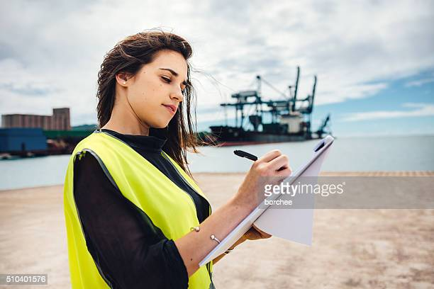 inspector at commercial dock - marine engineering stock photos and pictures