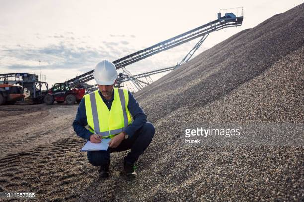 inspector at open-pit mine - izusek stock pictures, royalty-free photos & images