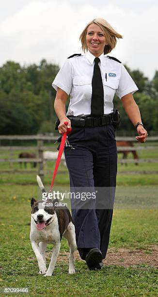 Inspector Bartle takes Saffron for a walk at the Southridge Animal Centre on July 29 2008 in London England Saffron had her ears cut off by her...