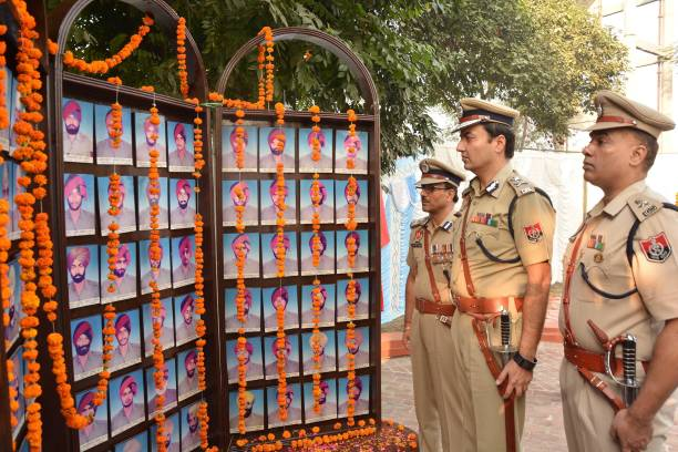 Inspector General SPS Parmar Deputy Inspector General AK Mittal and Senior Superintendent Police Parampal Singh stand during an annual Police...