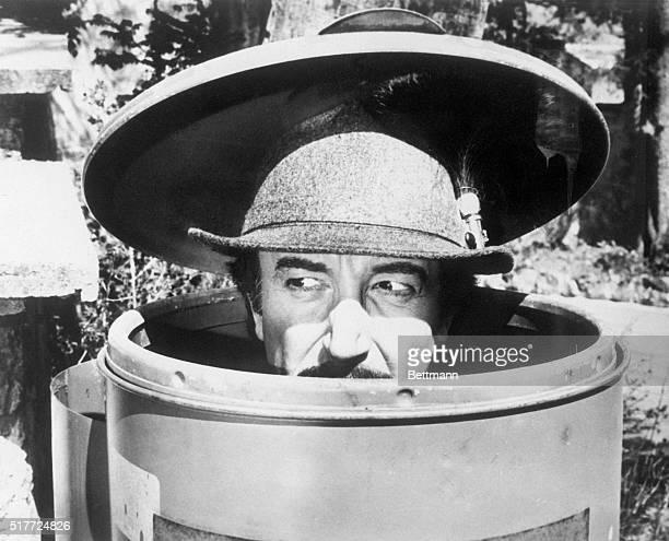 Inspector Jacques Clouseau hides in a trash can in The Pink Panther Strikes Again