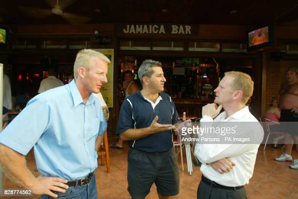 Inspector John Donnelly and Superintendent Andy Rhodes talk to local bar owner George Statiou as his Jamaica Bar in Bar Street Faliraki Greece The...