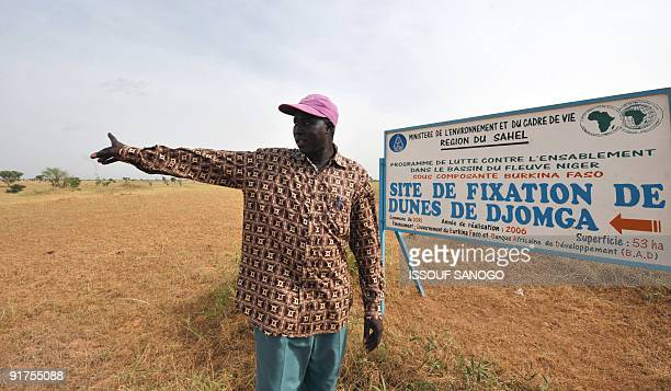 HIEN Inspector od water and forests Sylvain Kabore gestures on October 10 2009 near the village of Selbo in northern Burkina Faso where the locals...