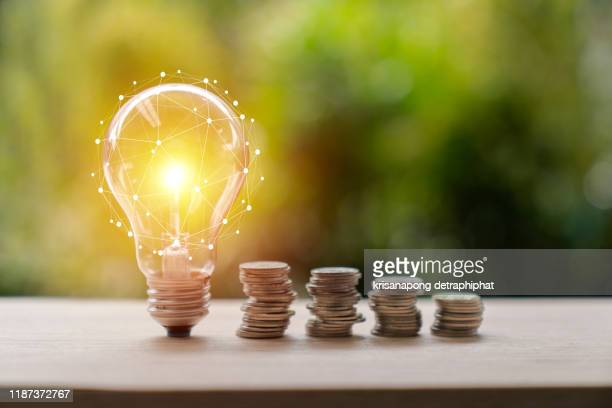 inspiration, ideas, light bulb, business, coin, market - retail space, gold, travel, white color, achievement, bank - financial building, banking, bright, business strategy, concepts, concepts & topics, creativity, c- saving concept,light bulb concept - making money stock pictures, royalty-free photos & images