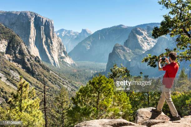 inspiration point view man photographing yosemite - pardo brazilian stock pictures, royalty-free photos & images