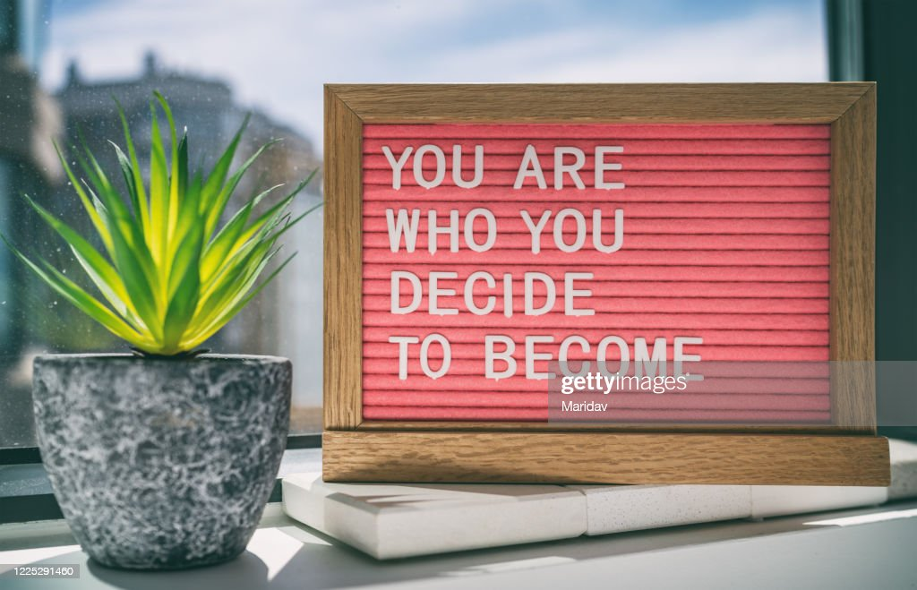 Inspiration quote message sign saying You are who you decide to become - life advice for self esteem, confidence. Home background : Stock Photo