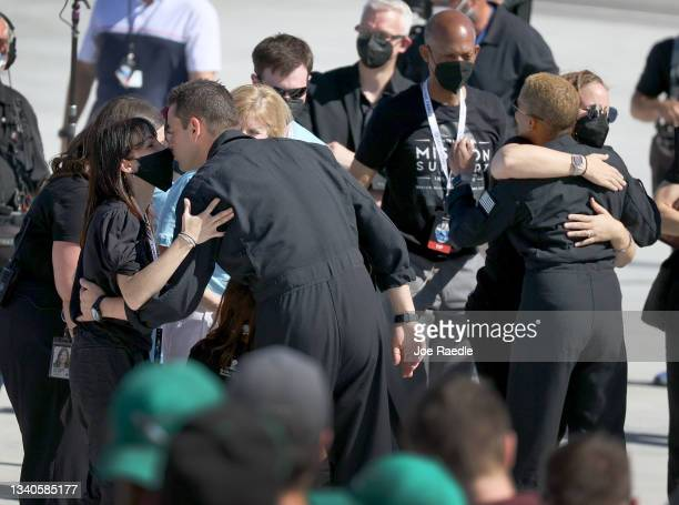Inspiration4 crew member Jared Isaacman and Sian Proctor embrace family and friends as they prepare to leave for their flight on the SpaceX Falcon 9...