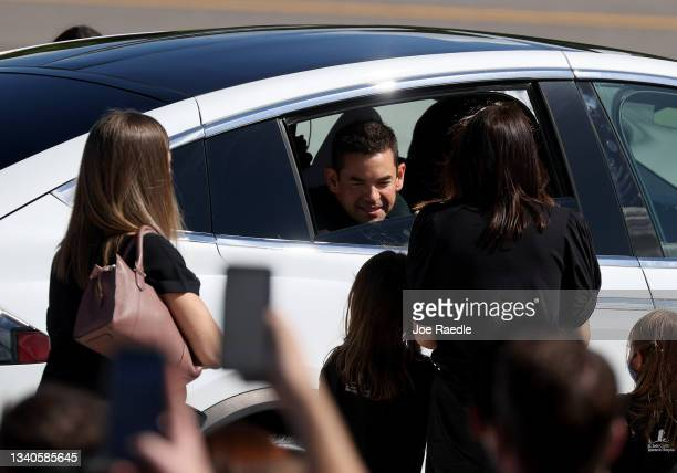 Inspiration4 crew member Jared Isaacman speaks with family and friends as he prepares to leave for a flight on the SpaceX Falcon 9 rocket and Crew...