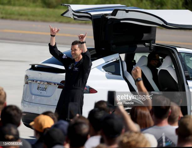 Inspiration4 crew member Jared Isaacman waves to the crowd as he and Sian Proctor, Hayley Arceneaux and Chris Sembroski prepare to leave for their...