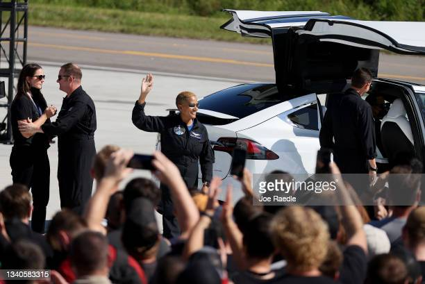 Inspiration4 crew member Sian Proctor waves to the crowd as she and Jared Isaacman , Chris Sembroski and Hayley Arceneaux prepare to leave for their...