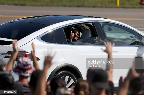 Inspiration4 crew member Sian Proctor waves to the crowd as she and Jared Isaacman, Hayley Arceneaux and Chris Sembroski prepare to leave for their...