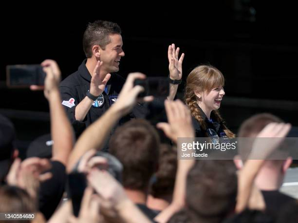 Inspiration4 crew members Jared Isaacman and Hayley Arceneaux prepare to leave for their flight on the SpaceX Falcon 9 rocket and Crew Dragon at...