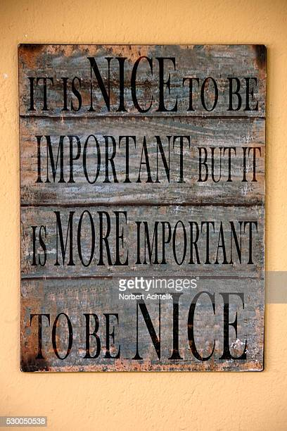 Inspirational and motivational quote written on a wooden board mounted on wall, South Africa