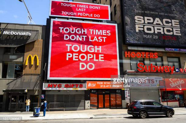 Inspirational billboards are seen in midtown during the coronavirus pandemic on May 25, 2020 in New York City. Government guidelines encourage...