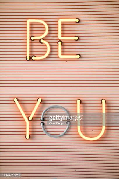 "inspirational quote "" be you"" in neon lights - igniting stock pictures, royalty-free photos & images"