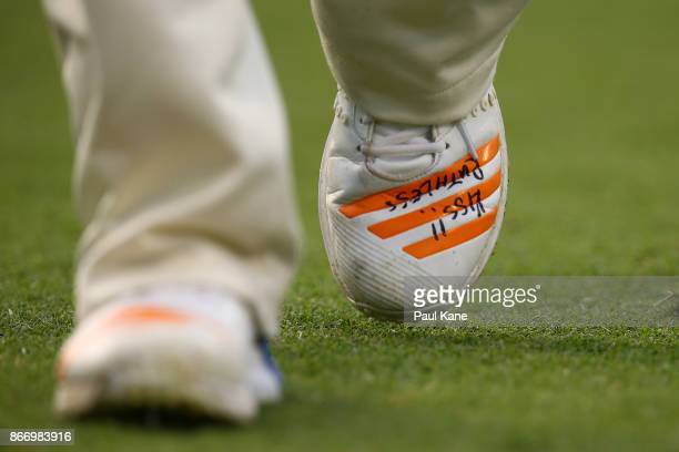 Inspirational quotes 'Keep It Simple Stupid' and 'Ruthless' are seen on the bowling shoes of Jhye Richardson of Western Australia during day two of...