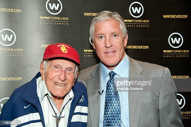 Inspirational speaker Louis Zamperini and Seattle Seahawks head coach Pete Carroll attend the Winforever Always Compete Speaker Series With Seattle...