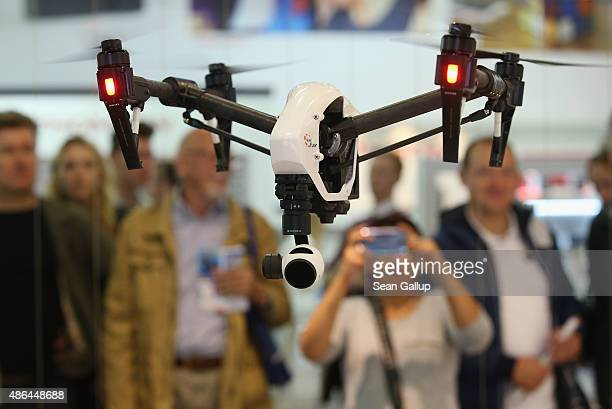 Inspire 1 quadcopter drone flies at the DJI stand at the 2015 IFA consumer electronics and appliances trade fair on September 4 2015 in Berlin...