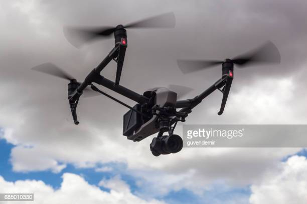 dji inspire quadrocopter flying - remote controlled stock photos and pictures