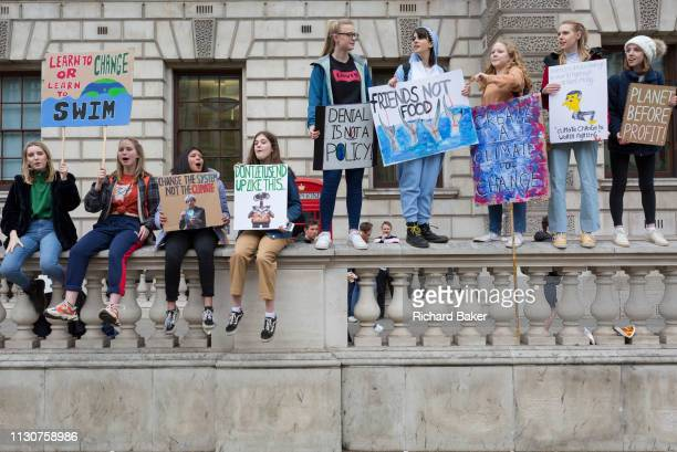 Inspired by Swedish teenager Greta Thunberg and organised by Youth Strike 4 Climate British ecoaware school and collegeage pupils protest about...