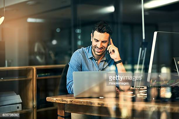 inspiring productivity with a wealth of technology - man in office stock photos and pictures