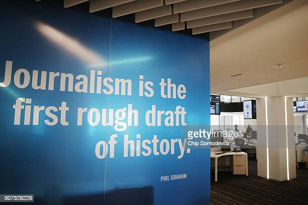 Inspiring quotes are written on glass walls in the Washington Post news room in its new headquarters January 28 2016 in Washington DC Founder and CEO...